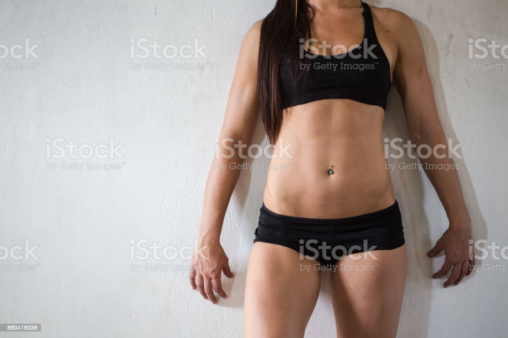 Close up image of the torso of a female fitness model stock photo