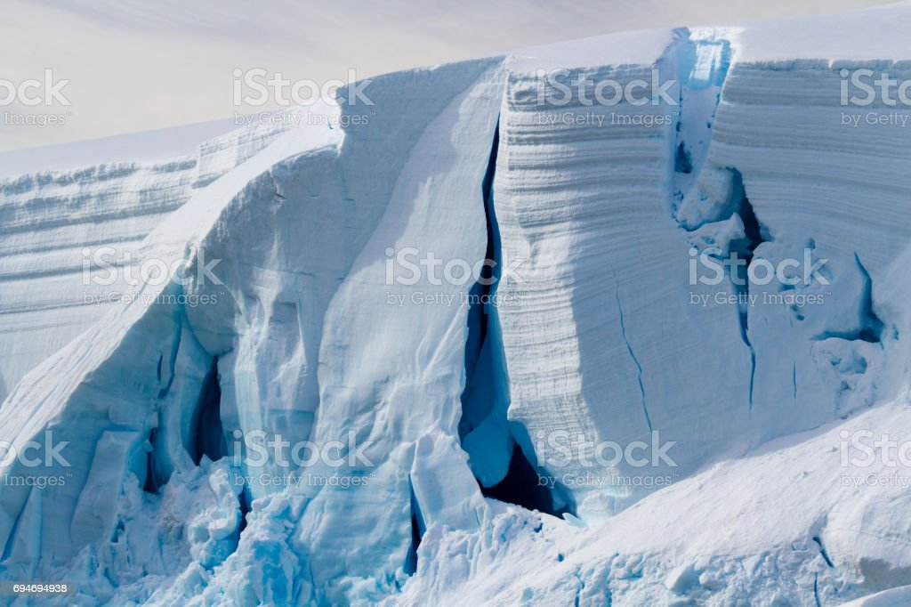 Close up image of white and blue ice and crevasse in a glacier's edge stock photo