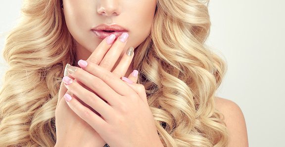 928358464 istock photo Close up image of womans fingers and lips. 646418132