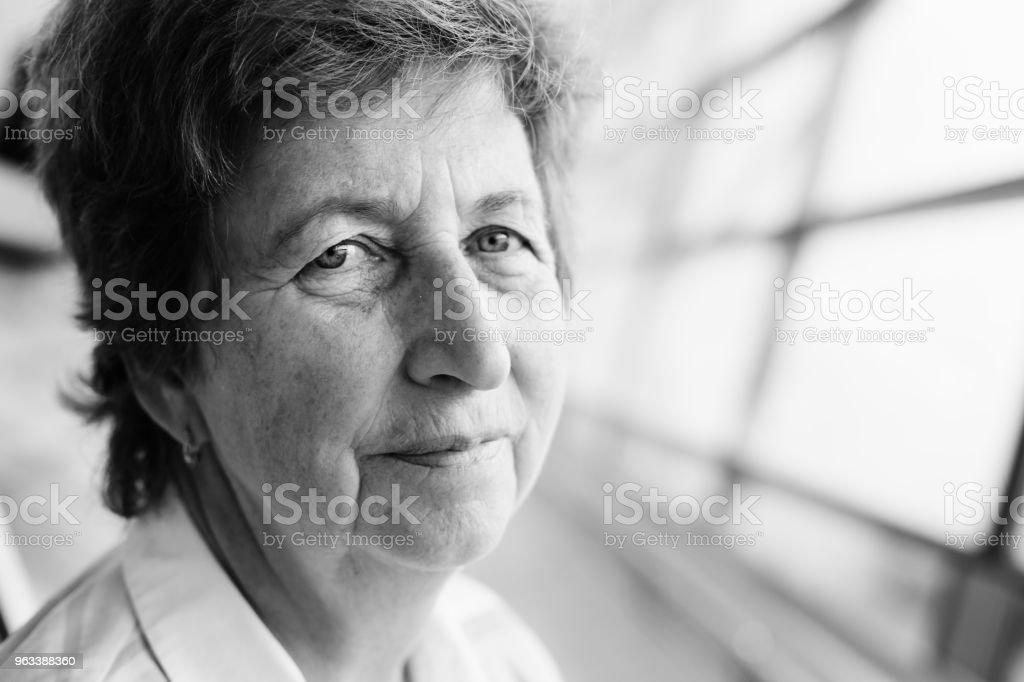 close up indoor portrait of 70 years old senior woman - Zbiór zdjęć royalty-free (1960-1969)