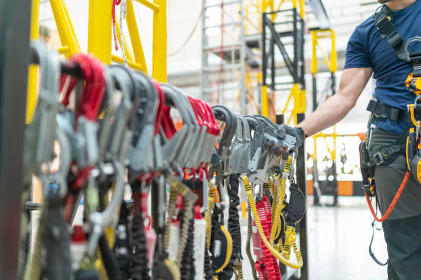 Close up industrial climbing equipment Close up industrial climbing equipment safety harness stock pictures, royalty-free photos & images