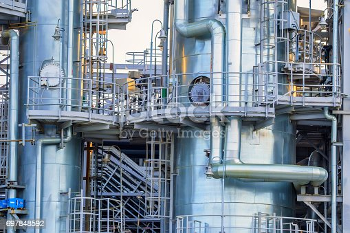 Closeup image of oil refinery plant with metal pipes