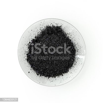 Close up inorganic chemical on white laboratory table. Potassium permanganate (KMnO4), a common chemical compound that combines manganese oxide ore with potassium hydroxide.