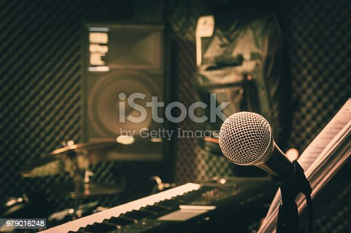 istock Close up instruments music background concept.Single microphone with keyboard and drum & speaker in home recording studio.Free space for creative design text & wording mock up template wallpaper. 979016248
