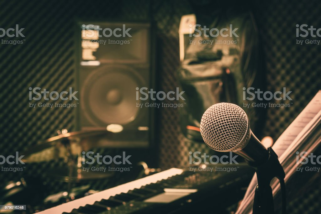 Close up instruments music background concept.Single microphone with keyboard and drum & speaker in home recording studio.Free space for creative design text & wording mock up template wallpaper. stock photo