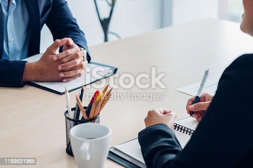 Close up interviewer interview candidate apply for job at meeting room in office