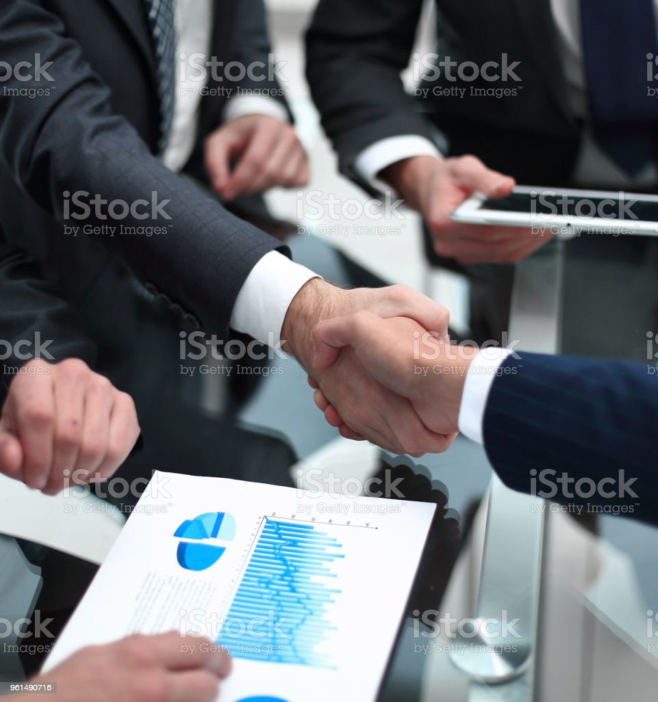close up. investor and businessman shaking hands stock photo