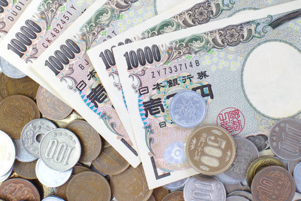 Close - up Japanese yen banknotes and Japanese yen coin stock photo