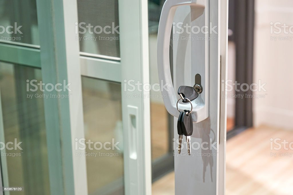 Close up Key and Glass door. stock photo