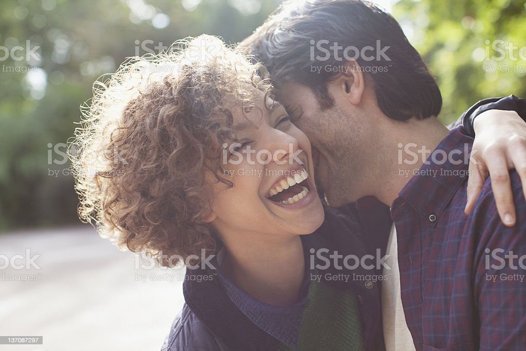 Close up laughing couple hugging stock photo