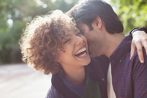 close up laughing couple hugging - falling in love stock pictures, royalty-free photos & images