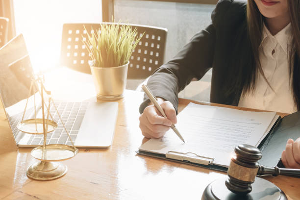 Close up lawyer businessman working or reading lawbook in office workplace for consultant lawyer concept. - Close up lawyer businessman working or reading lawbook in office workplace for consultant lawyer concept. - police meeting stock pictures, royalty-free photos & images