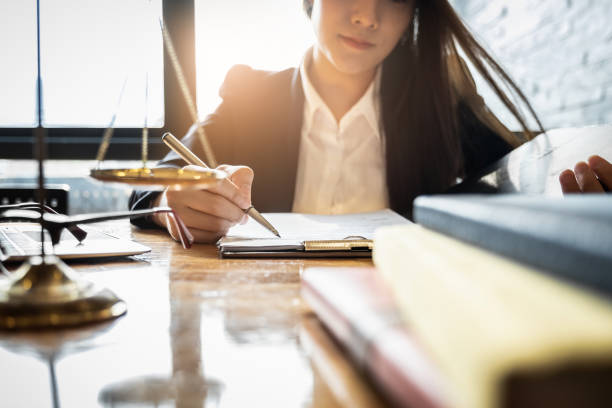 Close up lawyer businessman working or reading lawbook in office workplace for consultant lawyer concept. Close up lawyer businessman working or reading lawbook in office workplace for consultant lawyer concept. jurist stock pictures, royalty-free photos & images