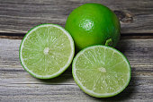 Close up limes om wood table.