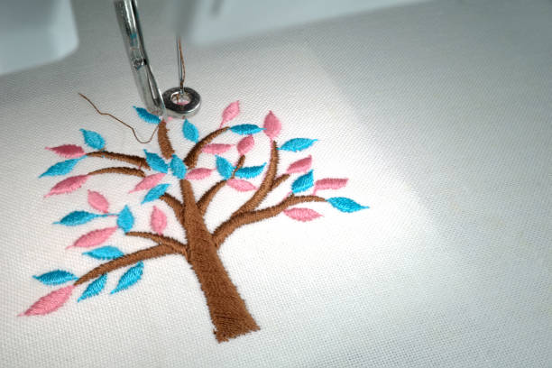 close up look of embroider minimal tree - tree logo stock photos and pictures