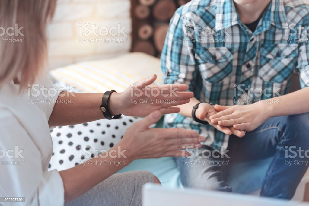 Close up look on hands of female psychotherapist and child stock photo