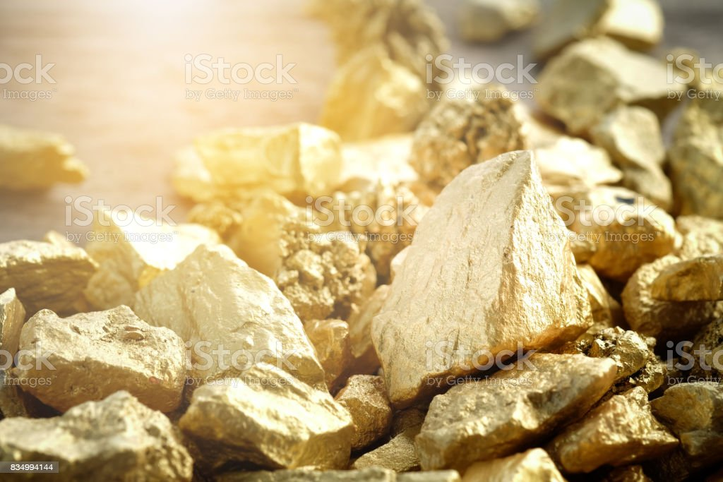 Close up lump of gold mine background texture stock photo