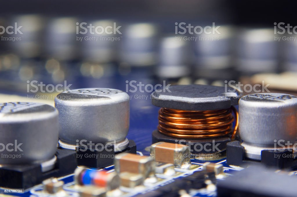 Close up macro of an Electromagnetic coil and electronic component. stock photo