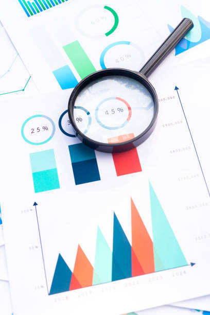 Close up Magnifying on Business Graphs finance document. Close up Magnifying on Business Graphs finance document. market research stock pictures, royalty-free photos & images