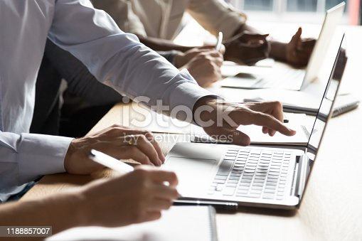 Close up male hands pointing at computer screen. Confident team leader explaining how to use corporate software to new employee. Businessman discussing project details with client at office.