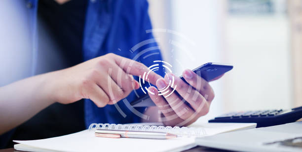 close up man hand holding smartphone and touch on screen for search information with virtual circle wheel future technology concept stock photo