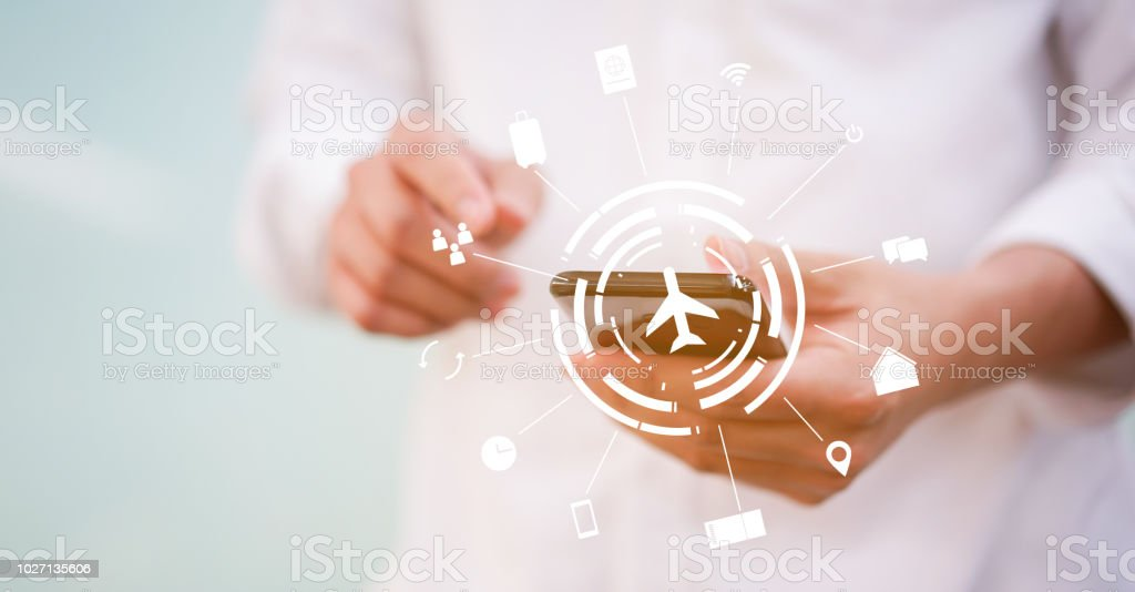 close up man hand using smartphone for booking travel with virtual interface of air transportation symbol technology or business  concept stock photo