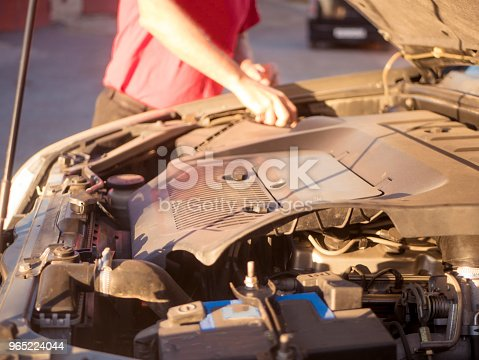 Close Up Man Repairing The Car With Opened Hood Stock Photo & More Pictures of Adult