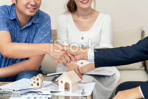 istock Close up, Man shaking hands represent sale, Asian couple meeting financial adviser for home, real estate purchase, success business contract deals with sale. Success deals. 1035897978