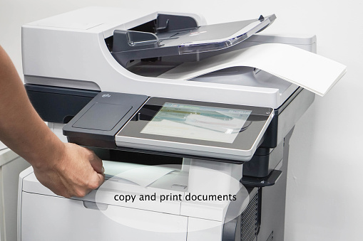 Close Up Man Take Printed Business Documents From Printer Stock Photo -  Download Image Now - iStock