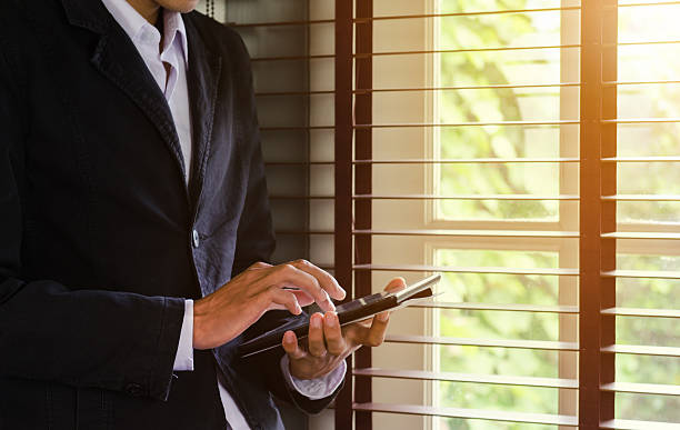 Close up man use tablet in home office stock photo
