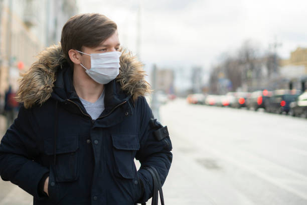 close up man wear cloth mask in the city, polluted air stock photo