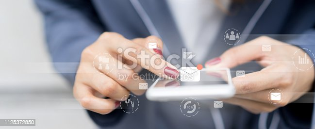 close up manager businesswoman hand touch screen on smartphone device for receive unread e-mail list or send mail to partner and customer , virtual reality interface technology concept with virtual reality interface
