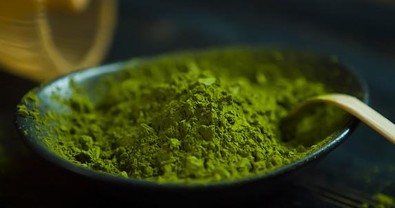 Close up Matcha. Organic Green Matcha Tea ceremony. Matcha powder. Cooking with matcha, recipe