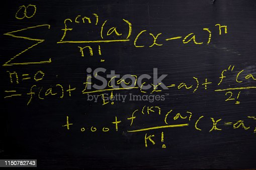 istock Close up math formulas written on a blackboard. Education concept 1150782743