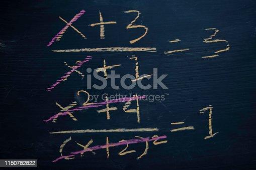 istock Close up math formulas written on a blackboard. Education concept 1150782822