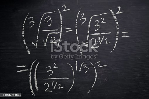 istock Close up math formulas written on a blackboard. Education concept 1150782846