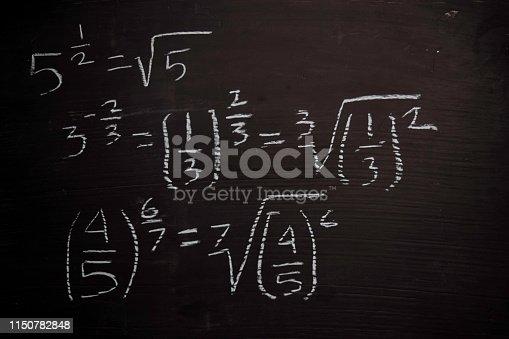 istock Close up math formulas written on a blackboard. Education concept 1150782848
