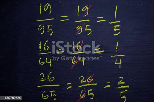 istock Close up math formulas written on a blackboard. Education concept 1150782870