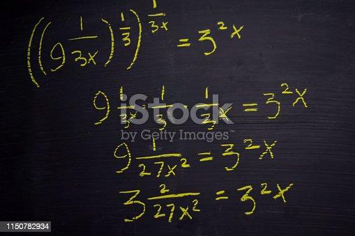 istock Close up math formulas written on a blackboard. Education concept 1150782934