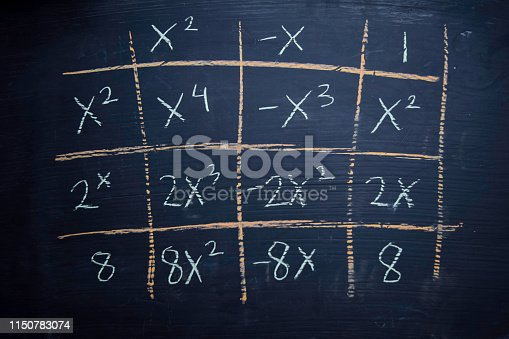 istock Close up math formulas written on a blackboard. Education concept 1150783074