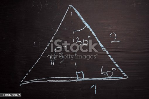 istock Close up math formulas written on a blackboard. Education concept 1150783075