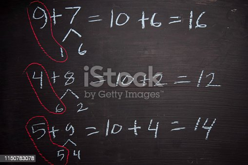 istock Close up math formulas written on a blackboard. Education concept 1150783078