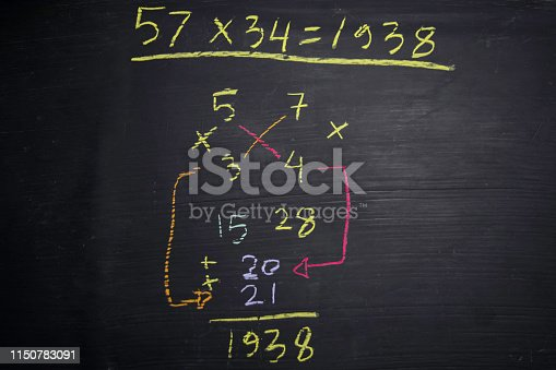 istock Close up math formulas written on a blackboard. Education concept 1150783091