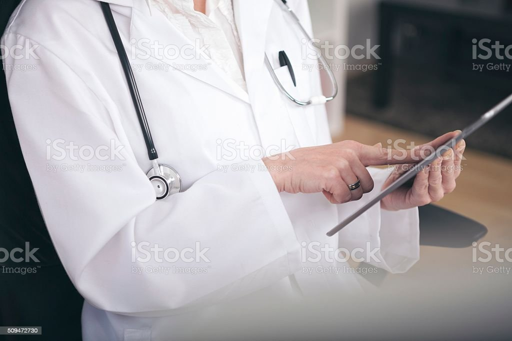 Close up Medical Doctor Using Tablet Computer stock photo