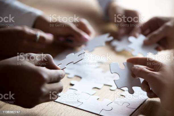 Close up members of multiracial team assembling white puzzle picture id1138382747?b=1&k=6&m=1138382747&s=612x612&h=vbanzggpv8ph3h1bkg5wgposmezs hsfrop6 jjvduy=