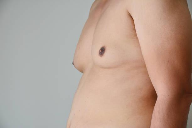 close up men boob fat man - seno foto e immagini stock