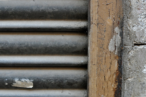 Close up metal door and building wall details