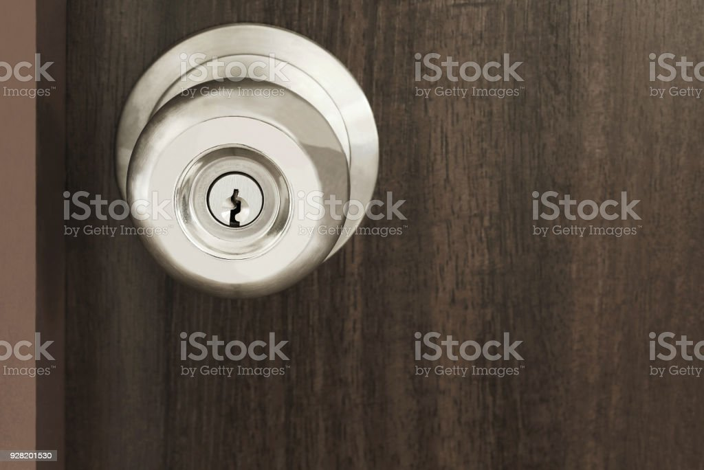 Royalty Free Front View To Modern Chrome Handle On Brown Wooden Door