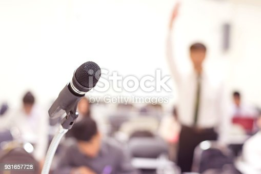 istock Close up microphone in conference on seminar room event background 931657728