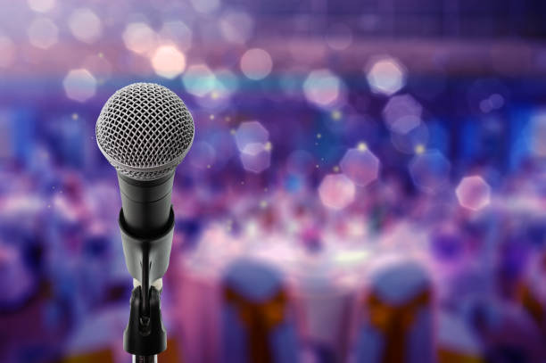 Close up microphone on stage in Ball room stock photo